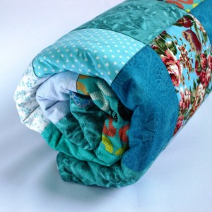 Swimming pool quilt rolled