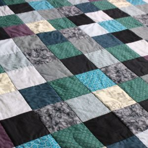 grey-blue-patchwork-quilt